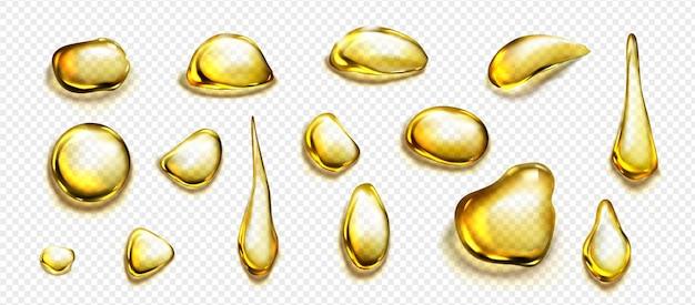Złote krople i kałuże oleju lub płynnego miodu na przezroczystym tle. wektor realistyczny zestaw kropli złota organicznego oleju kosmetycznego lub spożywczego, widok z góry wyraźnych żółtych plam