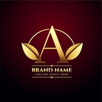 Złote liście list a logo koncepcyjne w stylu premium