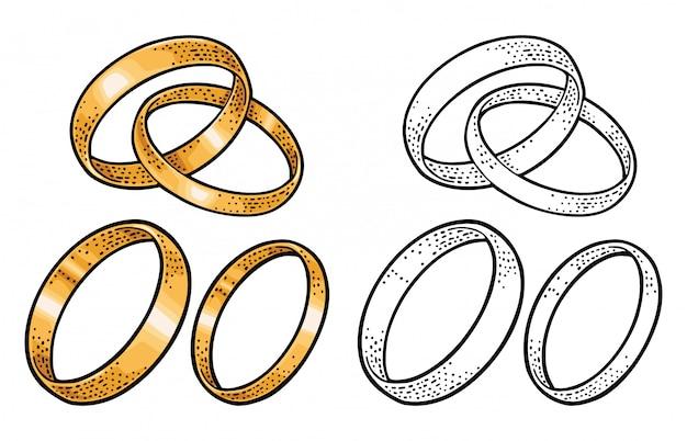 Złote obrączki ślubne. grawerowanie vintage na białym tle