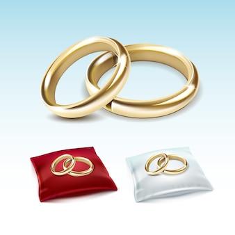 Złote obrączki ślubne na czerwonej białej satynowej poduszce
