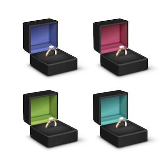 Złote pierścionki zaręczynowe błyszczące przezroczyste diamenty czarne kolorowe pudełka na biżuterię