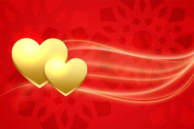 Złote serca na czerwonym backgorund na walentynki