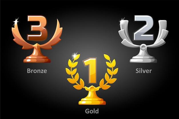 Złote, srebrne, brązowe nagrody dla zwycięzcy. zestaw luksusowych nagród za najlepsze miejsce dla mistrza gry.
