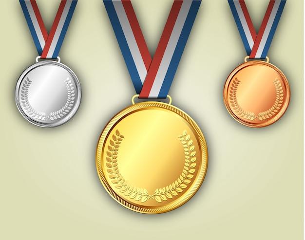 Złote srebrne i brązowe medale na wstążkach