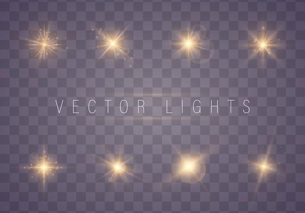 Złote światła błyszczy na białym tle. zestaw świecących gwiazd.