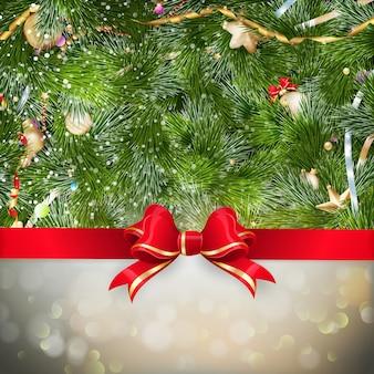 Złote życzenia bożonarodzeniowe z bombkami na gałęzi jodły.