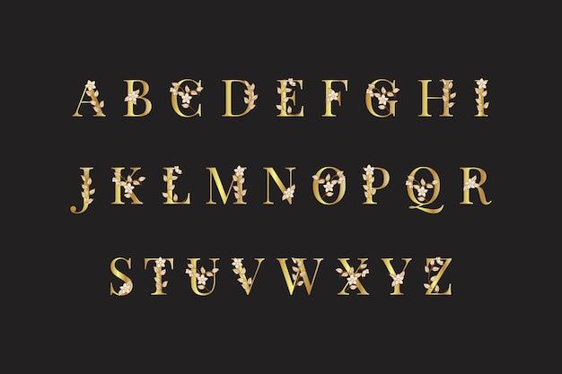 Złoty alfabet z eleganckimi kwiatami