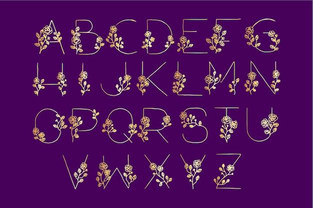 Złoty alfabet z kwiatami