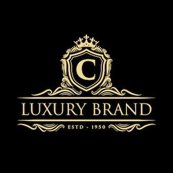 Złoty luksusowy vintage monogram kwiatowy logo ozdobny z szablonem projektu korony