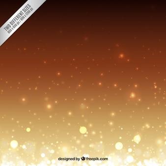 Złoty na brązowym tle bokeh