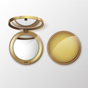 Złoty okrągły kieszonkowy kosmetyk tworzą małe lusterko na białym tle