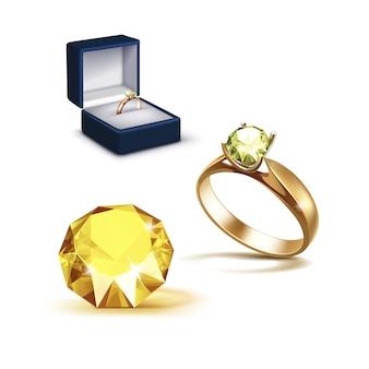 Złoty pierścionek zaręczynowy żółty błyszczący jasny diament niebieski pudełko z biżuterią