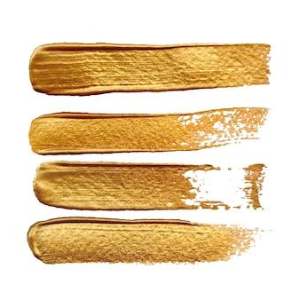 Złoty pociągnięcia pędzlem efekt na białym tle