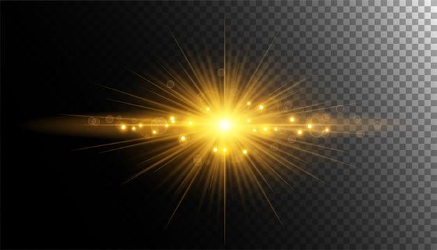 Złoty promień słońca z błyszczy lub złota cząsteczka światła świecidełka