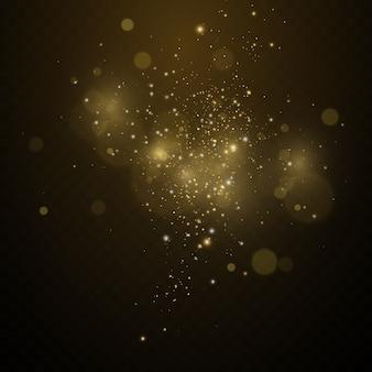 Złoty pył, żółte iskry i złote gwiazdy świecą specjalnym światłem. wektor mieni się błyszczącymi cząstkami magicznego pyłu.
