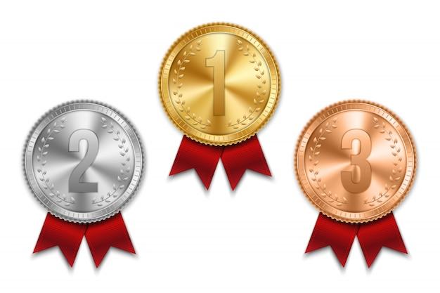 Złoty srebrny i brązowy medal ze wstążką.