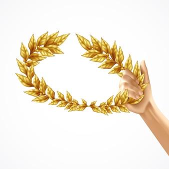 Złoty wieniec laurowy w ludzkiej ręki realistyczny projekt koncepcja na białym tle