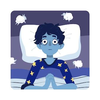 Zmęczony chłopiec w koncepcji bezsenności łóżka