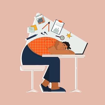 Zmęczony mężczyzna śpiący przy stole z laptopem