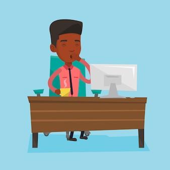 Zmęczony pracownik pracuje w biurze.