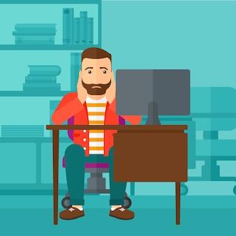 Zmęczony pracownik siedzi w biurze.