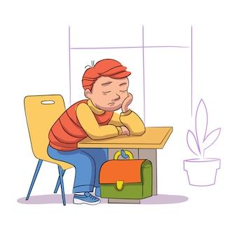 Zmęczony uczeń śpi w klasie. śpiący chłopiec siedzi na nudnej lekcji