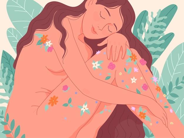 Zmysłowa naga kobieta ozdobiła swoje ciało kwiatami. zapach, piękno i przyjemność.