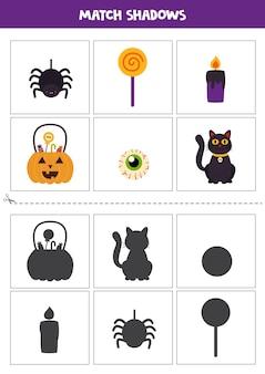 Znajdź cienie uroczych zdjęć halloween. karty dla dzieci.