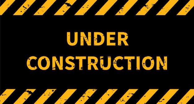 Znak budowlany w budowie. pasiaste tło czarne i żółte linie.