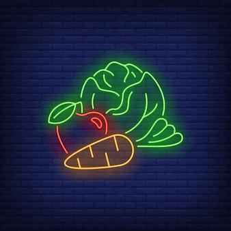 Znak neon kapusty, jabłka i marchwi.
