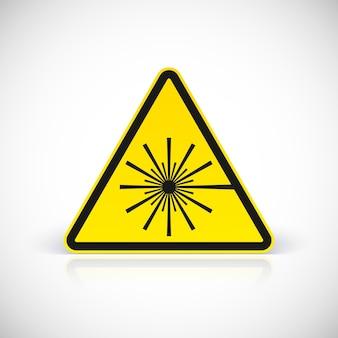 Znak ostrzegawczy zagrożenia laserem. symbol w trójkątnym znaku