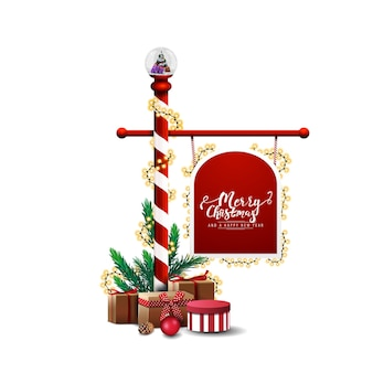 Znak strzałki z trzciny cukrowej kandyzowanego bieguna północnego ozdobione girlandą i prezentami na białym tle.