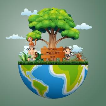 Znak światowego dnia dzikich zwierząt z chłopcem i dziewczynką odkrywcy