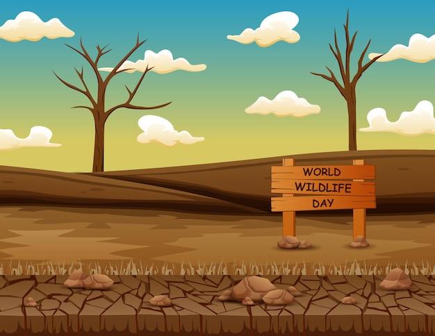 Znak światowego dnia przyrody z martwymi drzewami na suchym lądzie
