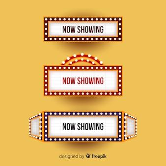 Znak teatru ze światłami tytułów spektakli