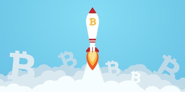 Znak waluty cyfrowej bitcoin z rakietą