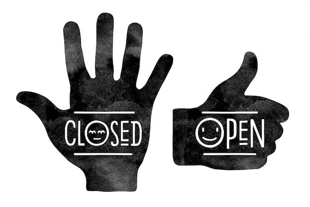 Znaki nawigacyjne. sylwetki dłoni w kolorze czarnym. zatrzymaj rękę ze słowem zamknięte i kciuk w górę ze słowem otwarte
