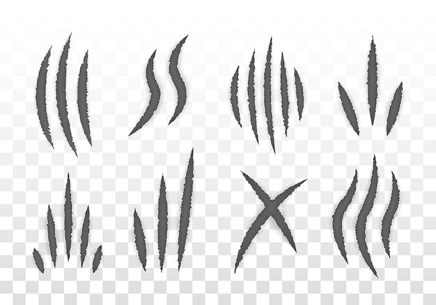 Znaki pazurów zwierząt (kot, tygrys, lew, niedźwiedź). zestaw pazurów potworów, zadrapania dłoni lub zgrywanie przez białe tło.