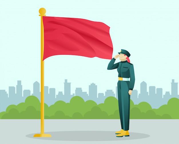 Żołnierz w mundurze salutowania stoi w pobliżu dużej flagi