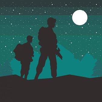 Żołnierze sylwetki sylwetki na scenie nocy