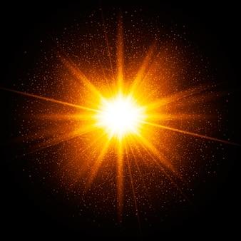 Żółta iskra. gwiazda wybuchła iskierkami. drobinki złotego brokatu, kurz. efekt przezroczystego światła świecącego. ilustracja na ciemnym tle