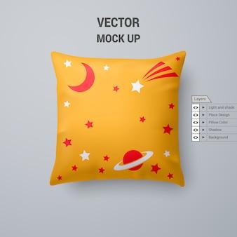 Żółta poduszka z kosmicznym wzorem na białym tle