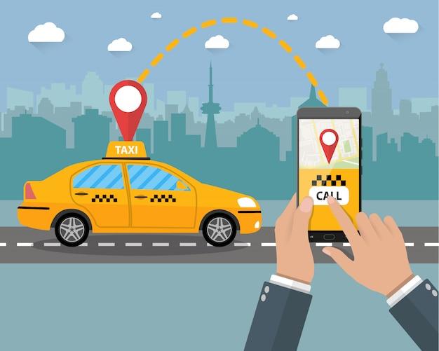 Żółta taksówka. ręce, smartfon, aplikacja