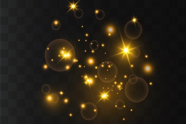 Żółte iskry i złote gwiazdy błyszczą ze specjalnym efektem świetlnym. lśniące cząsteczki czarodziejskiego pyłu. błyszczy na przezroczystym tle.