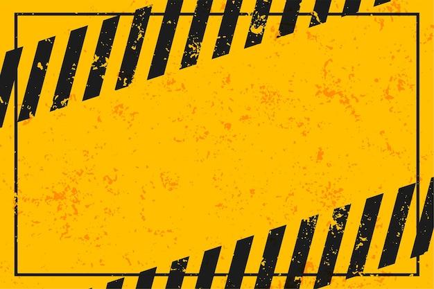 Żółte ostrzeżenie z czarnymi paskami