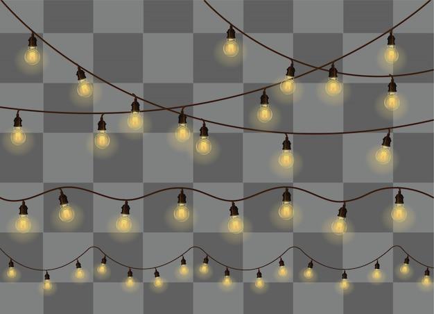 Żółte światła bożego narodzenia na białym tle realistyczne elementy. świąteczne lampki premium
