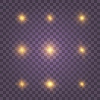 Żółte świecące białe złoto wybucha na przezroczystym tle. lśniące magiczne cząsteczki pyłu. jasna gwiazda. przezroczyste świecące słońce, jasny błysk. zestaw złoty żółty błyszczy.
