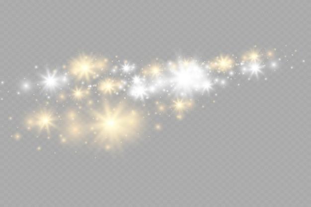 Żółte świecące światło eksploduje na przezroczystym tle iskrząc się magicznymi drobinkami kurzu jasnym st...