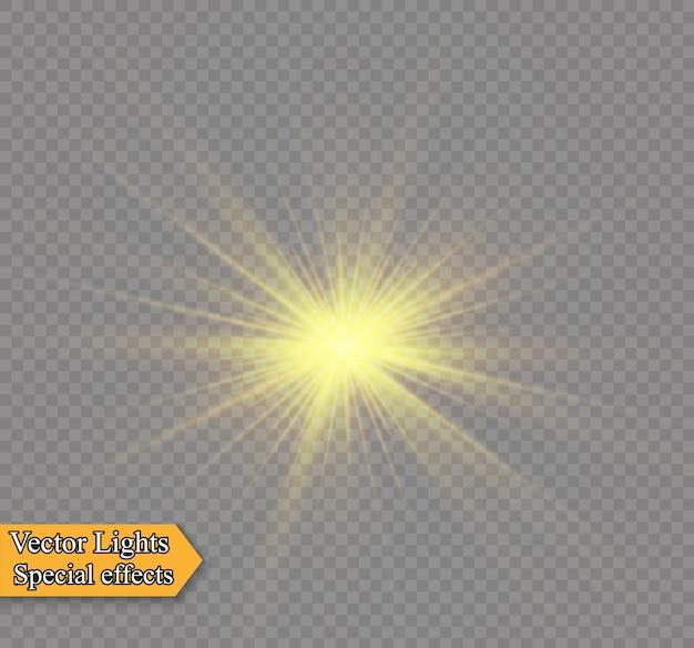 Żółte świecące światło wybucha na przezroczystym tle. lśniące magiczne cząsteczki pyłu. jasna gwiazda. przezroczyste świecące słońce, jasny błysk. błyszczy aby wyśrodkować jasny błysk.