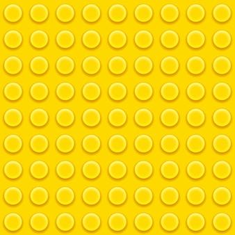 Żółty klocek z zabawkami